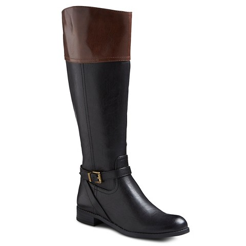 As you've no doubt noticed, Target's shoe department has been inundated with inexpensive boots ranging from classic black riding boots, to Western-inspired Frye knock-offs (above), to slouchy faux-suede knee-highs. I also spotted the token UGG knock-offs .